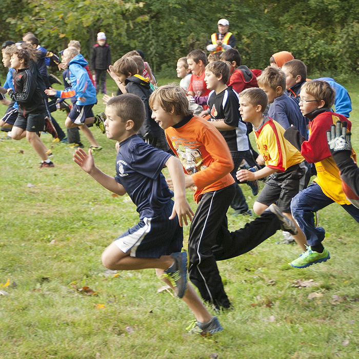 The boys head out on the course at the annual Catholic cross-country meet held at Thames Grove Conservation Area on Saturday.