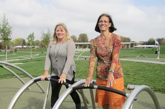 Deb Veccia, supervisor of parks and horticulture in Chatham, and Dr. April Rietdyk, director of public health, feel the burn on the outdoor fitness equipment at Kingston Park. The municipality held an official unveiling Oct. 16. The equipment was installed in late August.