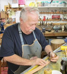 Marty King, owner of Longhorn Leather on Dolsen Road in Chatham, works on a belt in his shop. King's been doing leatherwork for more than 40 years, but opened his shop when he retired from truck driving 16 years ago.