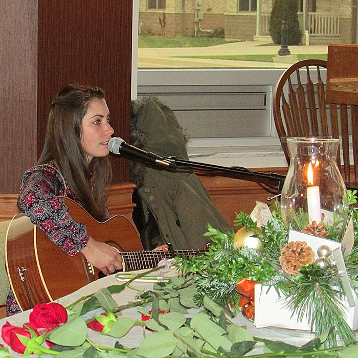 """Jessica Allossery sings """"Change the World,"""" which she wrote, to close Saturday's ceremony."""