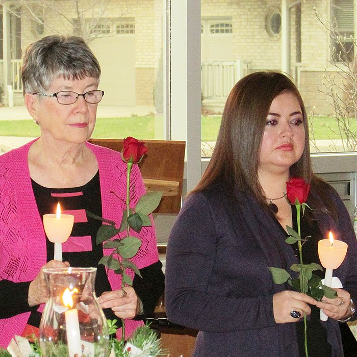 Participants in the Chatham-Kent National Day of Remembrance and Action to End Violence Against Women blew out a candle and laid a rose in honour of the 14 women killed 25 years ago in the Montreal Massacre at Ecole Polytechnique.