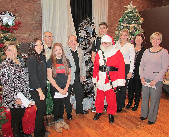 """Victory Ford handed out nearly $39,000 to a half-dozen local non-profit organizations Thursday. From left, Beverli Bryce of the Mitchell's Bay Area Association, Devin Cammaert of Victory Ford, Shawn Moynihan of Christmas in Muskoka, Alora Webb of the YMCA's Project Guatemala, Victory Ford's Don """"Sparky"""" Leonard, Santa Claus, Connor Szabo of the Chatham Ball Hawks, Laure Grincourt of Lincoln Motor Company, Kerry Lynn Buse of Kent County Girls' Hockey, and Nancy McDowell of Habitat for Humanity Chatham-Kent."""