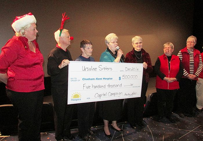 Members of the Ursuline Sisters hand over a cheque for $500,000 to Jennifer Wilson, left, and John Case (doing his Rudolph impression) of the Chatham-Kent Hospice. The hospice revealed its fundraising total of more than $5.7 million Saturday.