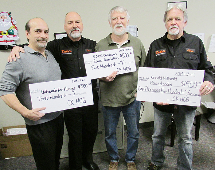 From left, local Harley Owners' Group members Augie DeMartinis, Dave Brooks, Rick MacFarlane and Chris Hall show off some of the funds their group donated recently to area charities.