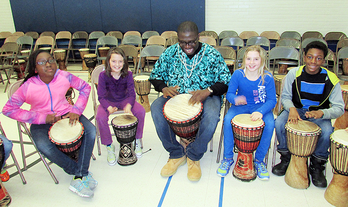 African-born Babarinde Williams, of Drums et al, taught kids at King George Public School the unifying effect of drumming in rhythm with each other at a full-day workshop Tuesday to kick off Black History month in the school.