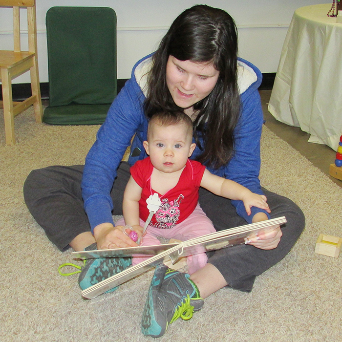 Vicki Hosfeld and daughter Hope took part in the OEYC Reading Party Tuesday afternoon at Queen Elizabeth school.