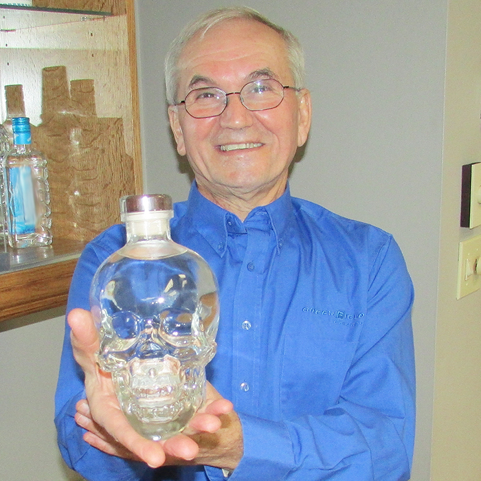 Angelo Ligori, plant manager of Greenfield Specialty Alcohols, showcases a bottle of Crystal Head Vodka, which recently earned high marks as the best vodka on the planet from several sources. Greenfield supplies the high-grade alcohol that is the base for Crystal Head.