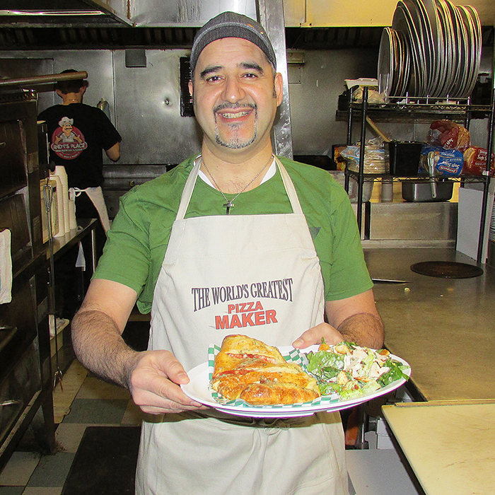 Koullies Styliano prepares a panzarlic at Andy's Place, which is celebrating its 35th anniversary.