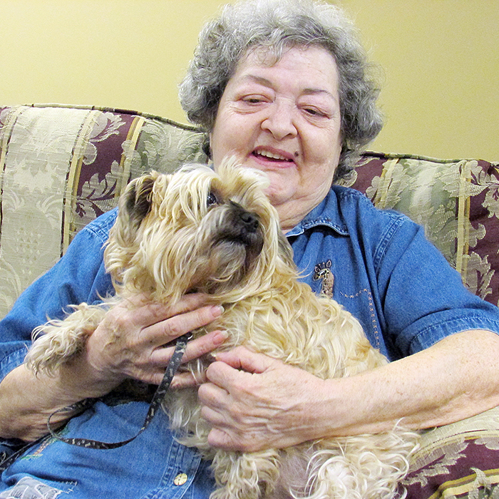 Doreen Suter hangs out with her pal Taffy. Maple City Retirement Residence allows residents to have small pets in their suites.