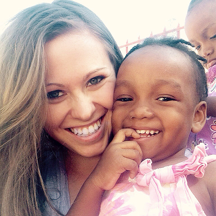 Emily Hime and three-year-old Jodnise, one of the children at her Maison Ke Kontan (Happy Heart House) children's home in Port Au Prince.