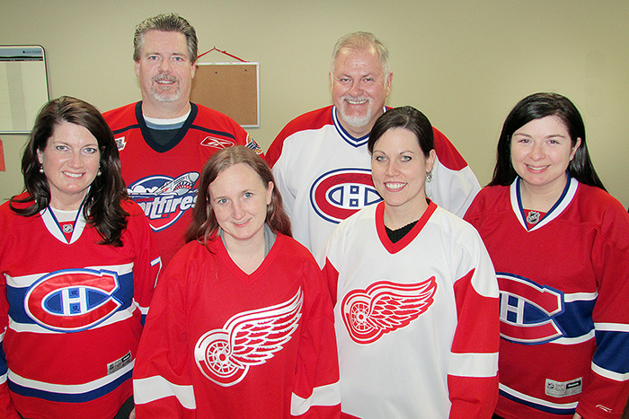Staff at The Chatham Voice got in on the Hockeyville spirit Monday, sporting hockey jerseys at the office and voting in the contest. From left, Darlene Smith, Bruce Corcoran, Michelle Owchar, Jim Blake, Tricia Weese, and Fatima Pisquem.