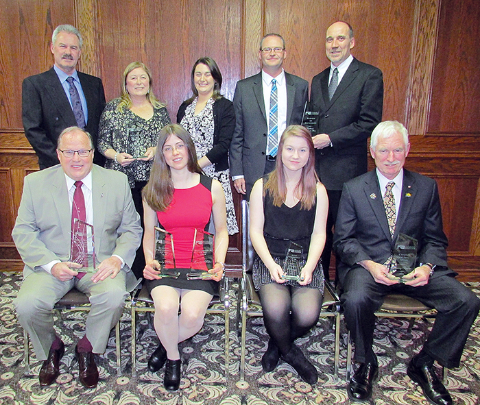 """The Chatham-Kent Chamber of Commerce held its annual awards banquet March 26, with a number of individuals and businesses being recognized. Back row, from left, Bob, Diane and Lisa Devolder of Devolder's Farms, Brad Goldsmith and Kevin Deacon of Southwest Granite & Glass. Front row, Don """"Sparky"""" Leonard of Victory Ford, Emily Meko of Eat What's Good, Jessica Weaver and Barry Fraser, youth entrepreneur of the year and citizen of the year respectively."""