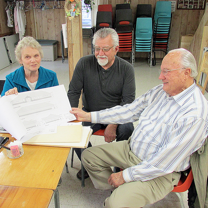 Group shot – Ina Aby, Ron White and Peter Shillington look over plans for the new Blenheim and Community Senior Centre.