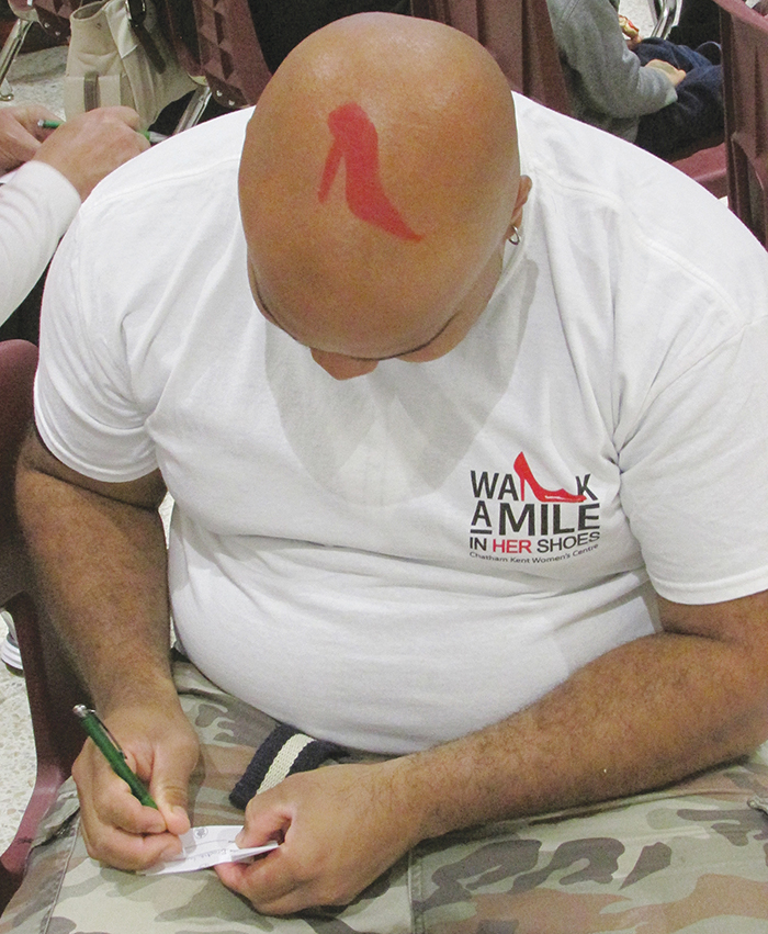 Supporters in the cause to raise awareness of violence against women marched through the Downtown Chatham Centre as part of the seventh annual Walk a Mile in Her Shoes event.