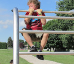 Youngsters wasted no time jumping on the newly dedicated fitness stations at the Tecumseh Public School Fit Trail on Tuesday. The one-kilometre trail was three years in the making. Here, Ryelly Hill, a Grade Three student, shows his muscles by doing a pull up.