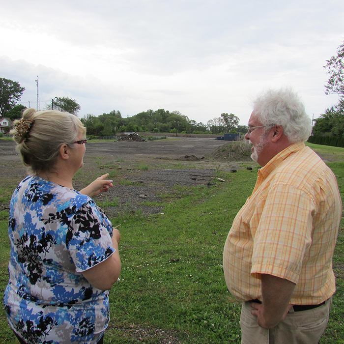 Co-chairs Marjorie Crew and Art Stirling stand on a berm above the site that will house the new animal shelter that their committee hopes to have replaced within the next three years.
