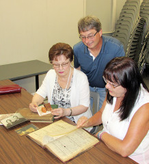 The Czech Hall in Dresden is home to a Czechoslovakian library of more than 1,000 titles thanks to the generosity of a local family. Nancy Gagnon, left, and her sister Joanne Bartosek donated the library of their grandfather Frank Lacina who immigrated to Canada in the 1920s. Here, the women examine Frank's ledgers that showed information about which books were lent. Looking over the information is Czech Hall president Al Kominek.