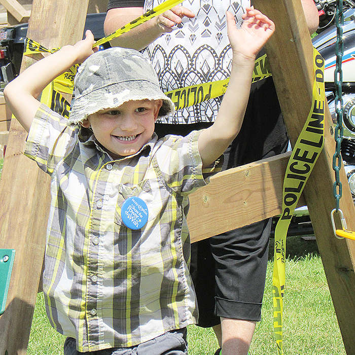 Michael, 6, reacts in joy to the unveiling of a play set. Michael's battling cancer, and the Make-A-Wish Foundation approached him to see what his biggest wish was. It turns out he wanted a play set where he and his sibling, Dallas, 5, could play together.
