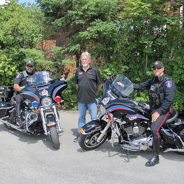 The Chatham-Kent Police Service took possession of two new Harley-Davidson Electra Glide motorcycles Wednesday. The two vehicles replace motorcycles from 2008. The bikes were purchased from Duke's Harley Davidson at approximately $30,000 each. Here (left to right) are Const. Todd Trahan, Chris Hall, General Manager of Dukes and Const. Scott Renders.
