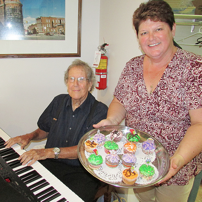 Jan Reinhardus, the new Recreation and Special Events Co-ordinator at the Active Lifestyle Centre in Chatham, offered cupcakes to Centre members as part of the 45th Anniversary of the ALC. Well-known local musician Ken Crone tickled the ivories during the Cupcakes and Coffee event Friday at the Centre. Staff are gearing up for the big event Aug. 30 with a barbecue and dance that already has a waiting list for tickets.