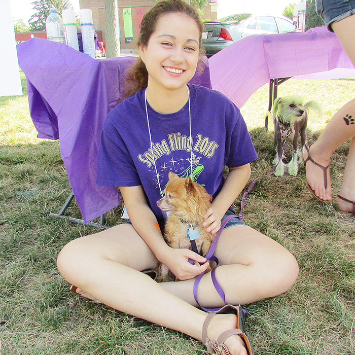 Yadell Innes of Chatham hangs out in the shade with Izzy during Dog Lovers Days 2015