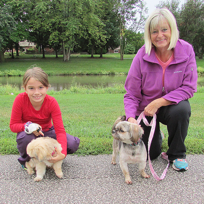 Callie Shepherd, 9, and Brenda Lucio took Hickory and Cosmo to the Friends for Life Walk Saturday.