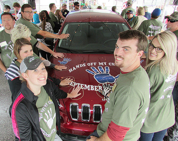 From left, Morgan Dale, Mackenzie Dale, Kevin Aikenhead and Jessica Vannieuwenhuyze are in it to win it at the annual Hands Off! event put on by Chatham Chrysler. The event started at noon Friday and likely will continue well into Saturday morning.