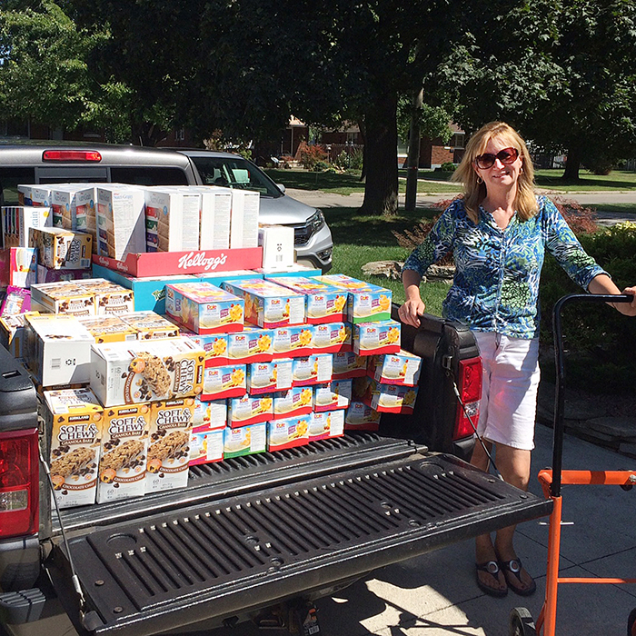 The May Court Club of Chatham Emergency Lunch Box (ELB) program convenor Sue Cummings showcases one of the truckloads of healthy snacks purchased for 25 Chatham-Kent schools. The May Court program fills the gap for students who run out of food or don't have enough food at lunchtime.