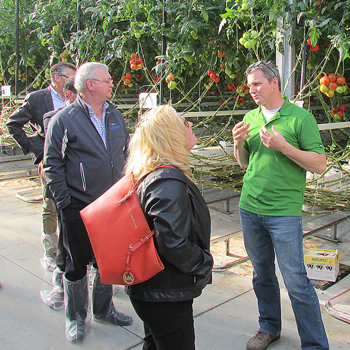 Truly Green's Hilco Tamminga discusses the intricacies of the company's greenhouse operation Oct. 15 with visiting members of the Chatham-Kent Chamber of Commerce.