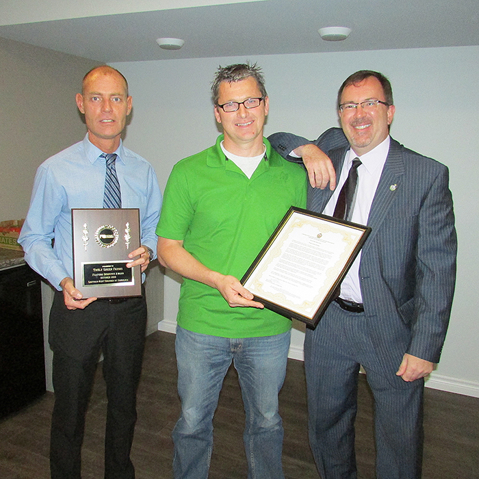 Hilco Tamminga, centre, of Truly Green, accepts accolades from Rob Brown of the Chatham-Kent Chamber of Commerce, left, and Chatham Coun. Darrin Canniff.