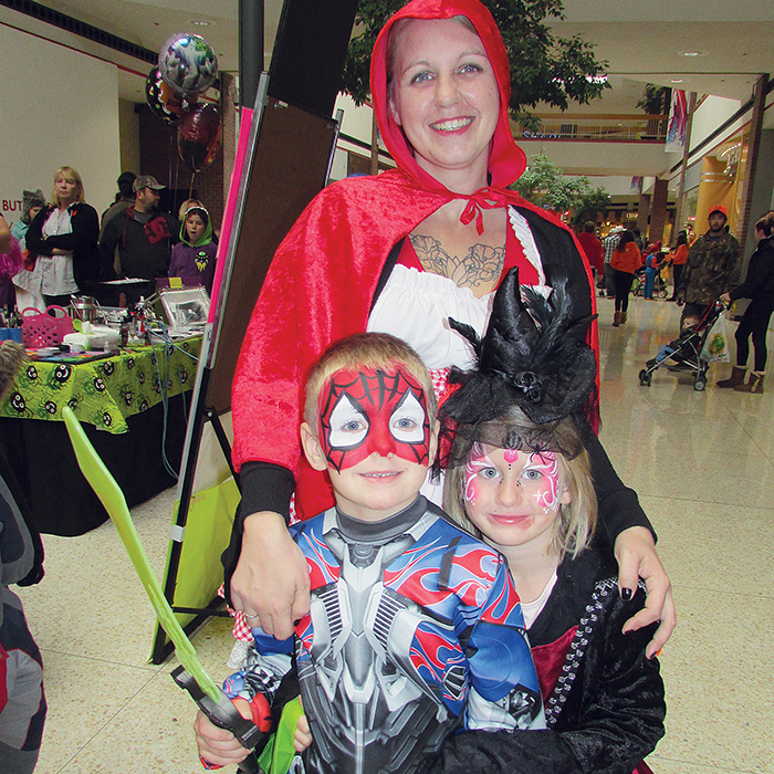 Jaxon McCallum, 6, and Avery St. Pierre, 4, take part in Saturday's Malloween fun at Downtown Chatham Centre, while Little Red Riding Hood – mother Kim McCallum, keeps watch.