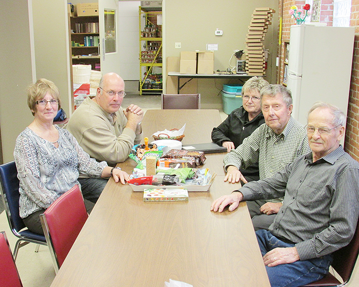 Plans are well underway for a Christmas concert next month featuring the Chatham-Kent Christian Men's Choir. Proceeds from the event will aid NeighbourLink Chatham-Kent and Chatham Outreach for Hunger. Here, from left, Brenda LcClair, George Flickweert, Sis Lalonde, John Wiebenga and Fred Postma meet to discuss the concert.