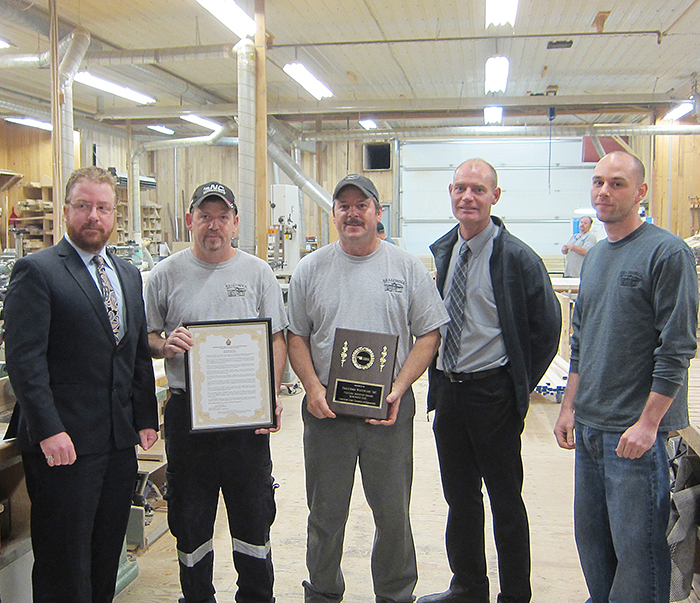 From left, acting Mayor Trevor Thompson ; Brett Eagen, Bradonna Woodwork; Brad Eagen, Bradonna Woodwork; Rob Brown, Chatham-Kent Chamber of Commerce; and Jeremy Eagen, Bradonna Woodwork celebrate the North Buxton company being named feature industry of the month.