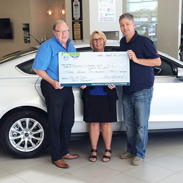 """Don """"Sparky"""" Leonard of Victory Ford, left, and Chris McLeod of CKSY, right, present a cheque for $3,120 to Michele Grzebien-Huckson, Executive Director, Foundation of CKHA."""