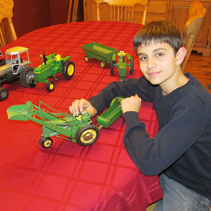 Mathew Sterling shows off some of the farm toys that will be on display during the 15th annual Chatham-Kent Toy Show and Sale Sunday, Jan. 17 at the John D. Bradley Convention Centre.