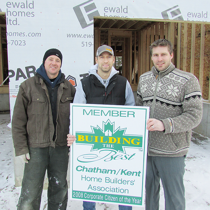 The Chatham-Kent Home Builders Association will be renovating a Chatham home for a nine-year-old girl who suffered a stroke last fall and is recovering from severe mobility issues. Here director Dave Ewald of Ewald Homes, CKHBA president Scott Vandersluis of Bouma Builders and Executive Officer Kevin Owen of Owen Flooring are seen outside a job site.