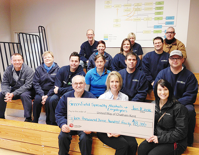 Angelo Ligori, plant manager, lower left, Katie Amato, head of human resources, and other GreenField Specialty Alcohols employees present a cheque for $18,340 to Megan Sealey, United Way campaign associate.