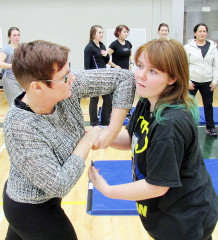 Jennifer and Destiny Hache practice some of the self-defence techniques taught by Henrie Timmers at his 12-week course at St. Clair College.