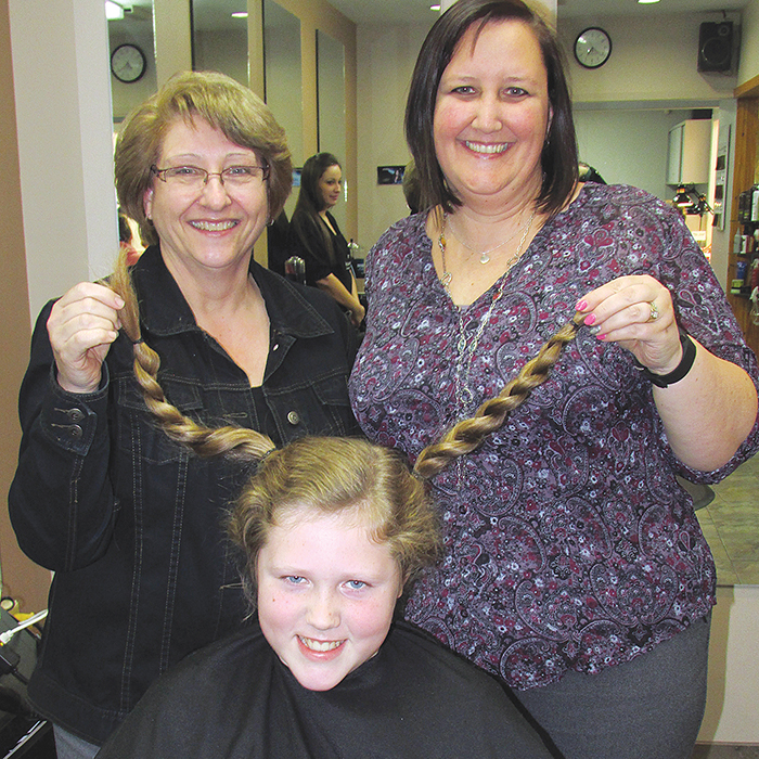 Inspired by a young girl he saw on a TVO Kids segment, Johnathan Core, 10, grew out his hair and had 12 inches cut off on live television to donate to Locks of Love to make wigs for cancer patients. Supporting him while he was live via Skype with TVO, were his Tecumseh Public School Grade 5/6 teacher Wilma Hunninck, left and vice principal Karyn Byatt-Millington.