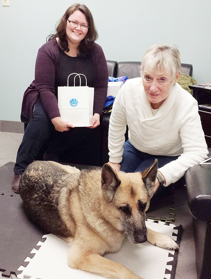 Robyn Brady of the OSPCA Kent County Animal Centre, hands Linda Melnick a thank-you gift for how she treats her long-time pet, Raven.