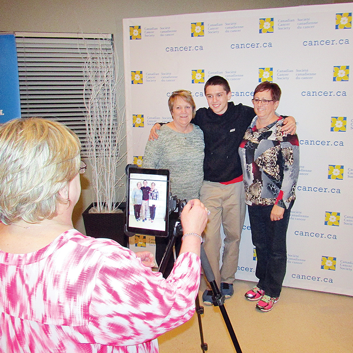 Members of the Tasmanian Teal Tigers showed up to register their team for the 2016 Relay for Life that will be held June 11. Mainstreet Credit Union was on hand to take fun photos of the teams. Here, Tammy Bettencourt of Mainstreet takes a photo of (left to right) Marlene Atkinson, Hayden Atkinson and Cheryl Carroll.