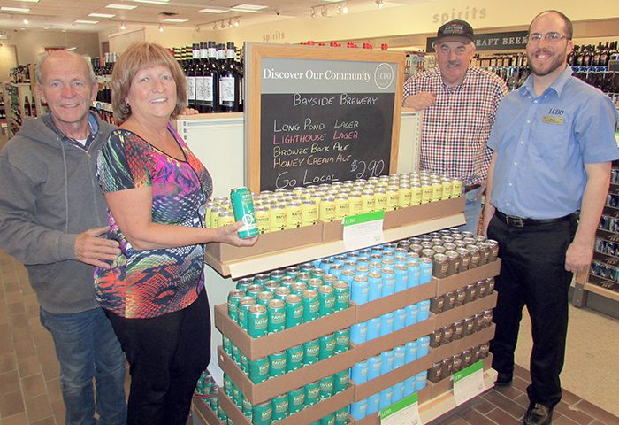Bayside Brewing Co. owners, from left, Ken Royal, Nancy Cowan and Frank Thompson celebrate with LCBO beer ambassador Rob Shaw over the fact LCBOs in downtown Chatham and Blenheim are now selling the local craft beer.