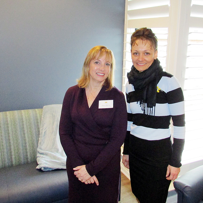 Aileen Murray of the Chatham-Kent Hospice fundraising committee, left, and St. Andrew's Residence's Irene Spisar were just two of the dozens of people who stopped by April 5 to check out the new hospice and the grand opening ceremony for the facility.