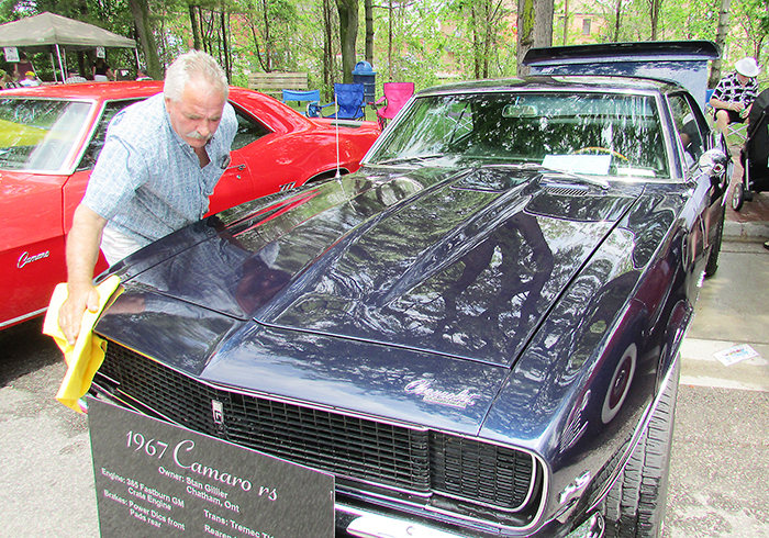 Stan Gillier polishes his new 1967 Chevy Camaro after a little rain sprinkled down over Retrofest on the weekend in Chatham last year.