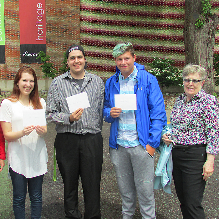 The Chatham-Kent Film Group presented $1,000 bursaries to three local students who will be enrolling in post-secondary film studies courses this year. Here (left to right) are film group member Irena Carey, winners Julianna Corso, Anthony DeWael and Riley Rhodes and Cindy Storey of the film group.