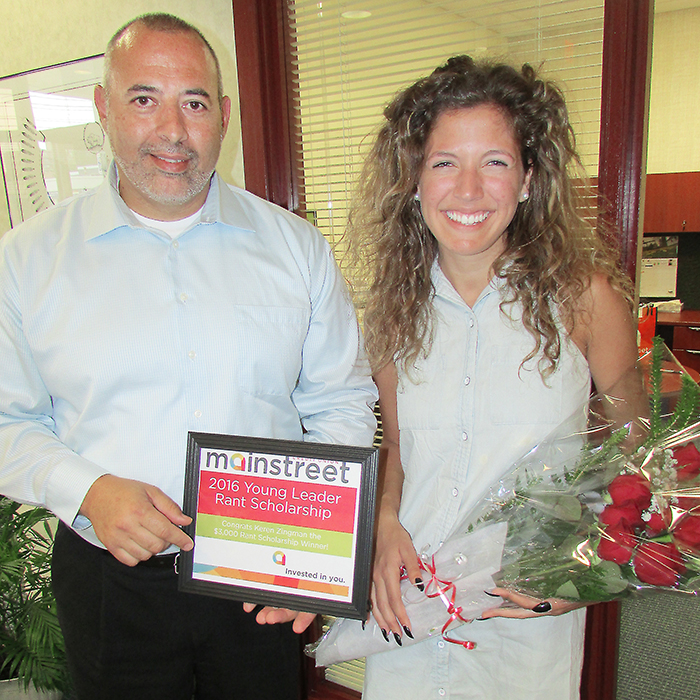 Mainstreet Keil Drive branch manager in Chatham, Joe Presutto, presented Keren Zingman with a scholarship cheque for $3,000, a certificate and a bouquet of roses on recently.