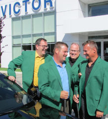 The first annual Festival of Golf will be held Friday September 16 at the Willow Ridge Golf and Country Club. Proceeds of the event will be donated to the Chatham-Kent Children's Treatment Centre. Here golfers Darrin Canniff, Dave Matteis, Don Leonard and Michael Grail check out the winners' green jackets while standing next to a new Ford Mustang that will be won by one golfer.