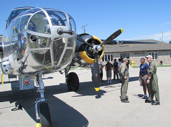 Flight crew and folks who signed up for a flight over Lake Erie chat about The Yankee Warrior, a Second World War vintage B-25 medium bomber that was the focal point of CK Flight Fest Saturday.