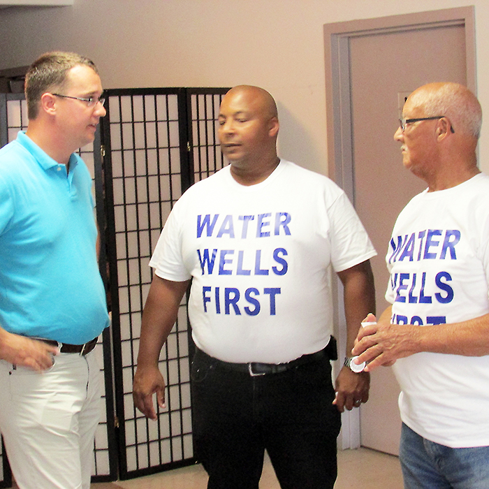 Lambton-Kent-Middlesex MPP Monte McNaughton chats with members of Water Wells First at a recent public meeting to discuss the proposed Otter Creek Wind Farm north of Wallaceburg.