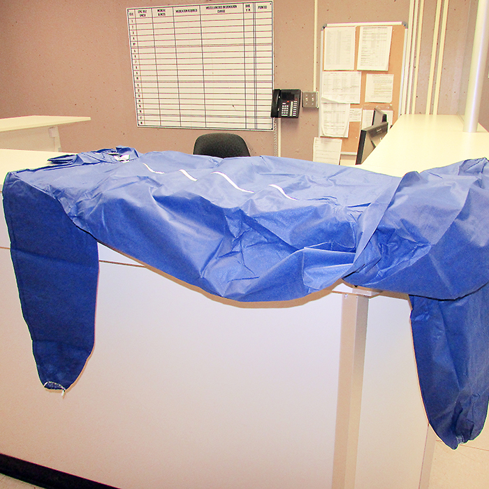 The blue jumpsuit draped over the booking desk at Chatham-Kent Police Services headquarters is offered to people, men and women, who have been asked to remove undergarments as part of the booking procedure.